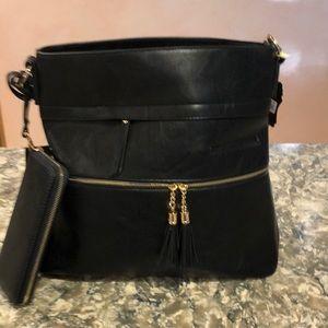 Black vegan leather designer handbag